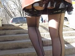 Sexy girl in seamed stockings going upstairs 2