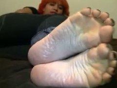 Redhead girl posing her feet