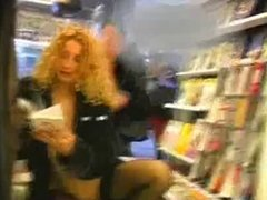 2 women flash in airport book store