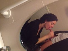 WIFE GIVES BLOWJOB IN THE PUBLIC TOILET