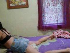 Amateur teen in skirt grinds pillow on webcam
