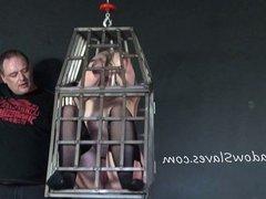 Caged blonde female slaves whipping and hanging bondage