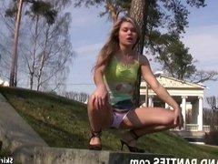 Dirty blonde flashing her panties outdoors