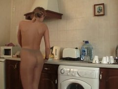 Long Legs In Pantyhose On The Kitchen Counter