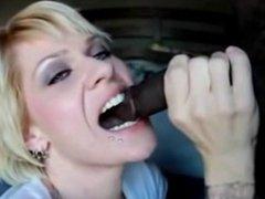 kinky slut bites hard in a black cock