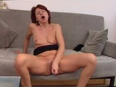 Brunette milf masturbating with glass dildo