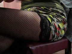 Girl check her fishnet stockings in restaurant
