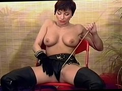 British slut Vida plays with herself in leather boots