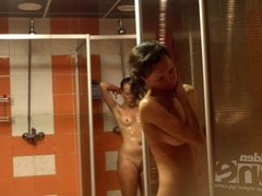 Several naked women in a shower room