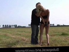 Blonde Mia bound and fucked on the plain