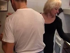 Cute milf in kitchen
