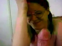 Brunette with glasses strokes and swallow cum