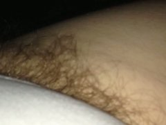 close up of the wifes pubic hair hainging from her panties