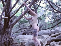 Tattoed alt girl posing naked in the open air