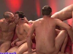 Group of jocks jumping on dicks