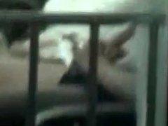 asian boy caught through his window