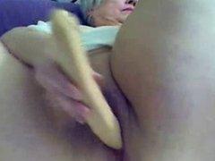 Old fat slut granny masturbates on web cam