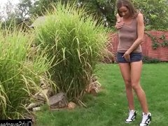 Tiny titted teen Adriana masturbating in the garden