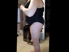 bbw wife slipping into her black girdle over black pantys