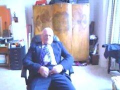 Older men shoot on his suit