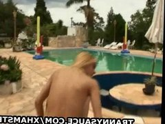 Blonde shemale babe Camilla Rios jerks it poolside