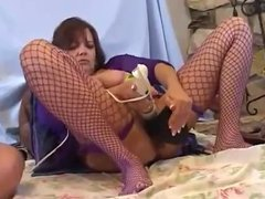 woman stuffing toys in her pussy