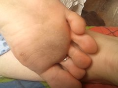 My girlfriend's dirty feet candid closeup