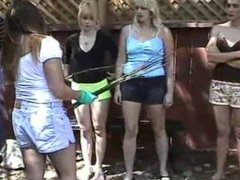 Four women caning man