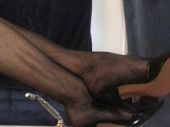 Foot tease in sheer black stockings and mules