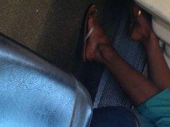 Indian woman barefoot shoe change on train