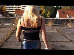 Blonde walking in Black Latex