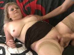 Mature mom squirts and takes young cock