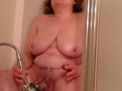 Mom gets off with showerhead