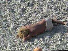 Voyeur on public beach. Funny dancing