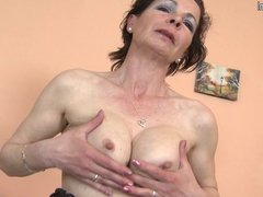 Naughty mature mom playing with fingers and toy