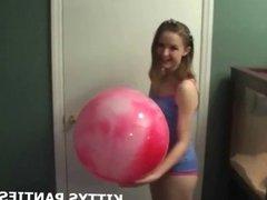 Kitty blowing bubbles in a cute little skirt