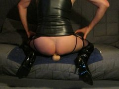 Monsterdildo ride in thigh boots and latex mask