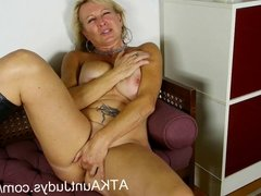 Nicole fingers her wet mature pussy to get off.
