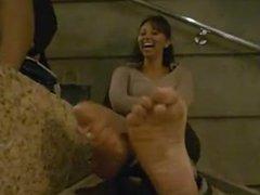Ebony feet talk on the stairs