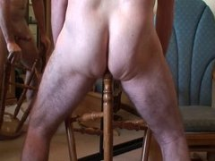 Riding a wooden barstool leg!