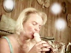 A horny MILF riding an 8 inch dildoe