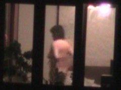 Naked woman in window