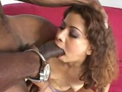 Nasty black slut chokes on big cock