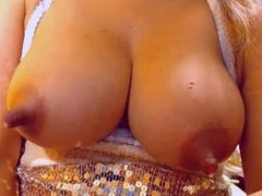 Amazing long nipples on milk filled breasts
