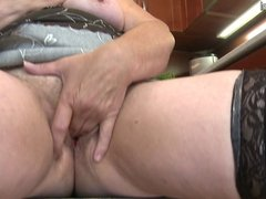 Dirty granny with saggy tits rides black dildo