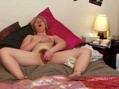 Bushy blonde masturbates