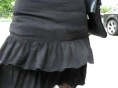 Girl in a seamed stockings in a windy day