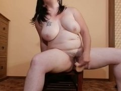 Hairy chubby girl riding her dildo