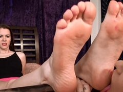 She experiments with women by letting one lick her feet!