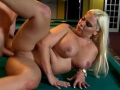 Busty blonde fucked on a pool table